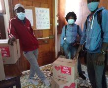 Familias de Barrio Puerto recibieron cajas sanitizadas de mercadería